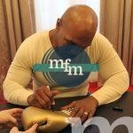 mike-tyson-signing-gold-boxing-glove
