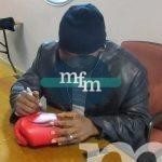 mike-tyson-signing-red-tattoo-boxing-glove
