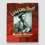 Sir-Norman-Wisdom-signed-book-'Lucky-Little-Devil',-Hardback