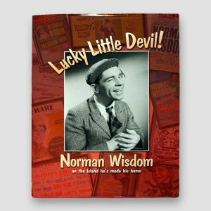 Sir Norman Wisdom Signed 'Lucky Little Devil' Hardback Book