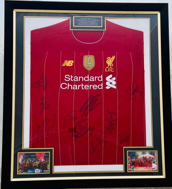 Liverpool Football Shirt signed by Liverpool squad , professionally framed.