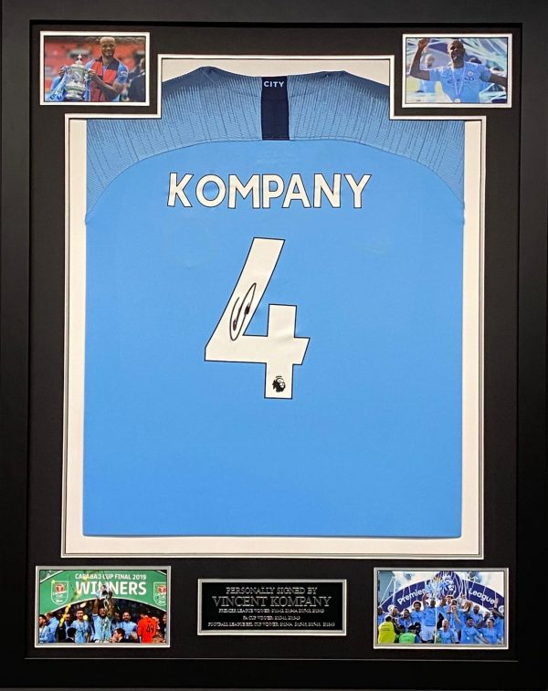 Manchester City shirt signed by Kompany , professionally framed