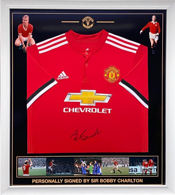 Manchester Utd shirt signed by Sir Bobby Charlton  , Professionally framed